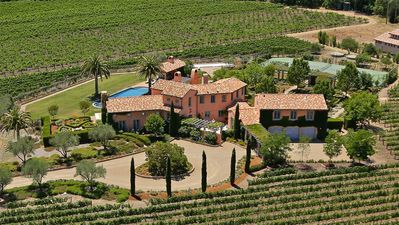 Aerial view of property surrounded by vineyard