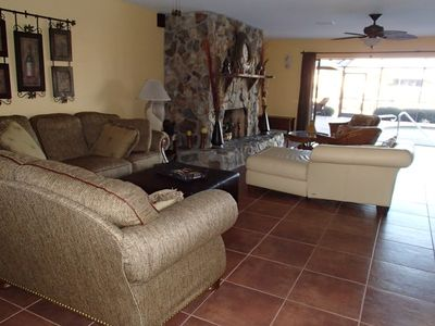 Great room open to swimming pool and enclosed lanai.