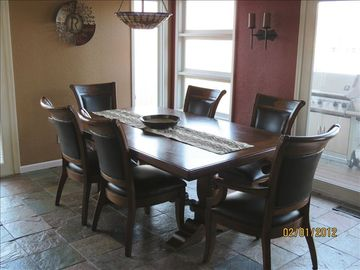 Dining room table (seats up to 10), easy access to deck, & great view of cove.