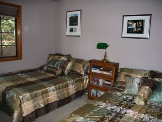 Lake Almanor house photo - Bedroom #3 has two double beds and looks out to the pine trees.