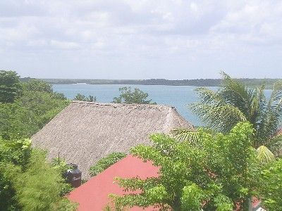 View of Lake Bacalar.  Presently closed restaurant in front.