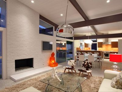 Family with gas fireplace and view to dining and kitchen beyond
