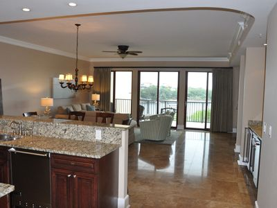 Overview of Living Area. All Travertine Tile Floors w/ Carpeted Bedrooms