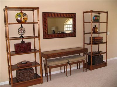 E-mail family with your laptop at this wall unit with two benches.