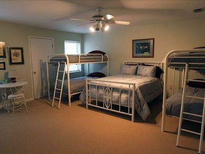 Upstairs bunk room with double bed and two bunk beds
