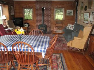 Surry cottage photo - Living room. Water to the left of picture.