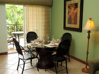 Playa Herradura condo photo - Dining table seats four. The balcony features a table with two comfy chairs.