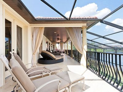Over 90 ft of balconies, overlooking the lakefront Loungers and 55 inch TV