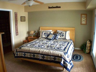 Fourth bedroom with king size bed, French doors to deck, wheelchair accessible