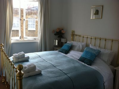 The master bedroom overlooks a quiet residential street