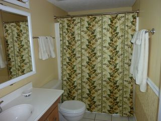 Guest bathroom in palm tree decor. - Fort Walton Beach condo vacation rental photo