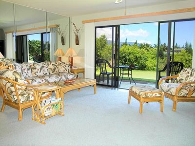 Relax and enjoy the mountain and ocean views from the confortable living room.