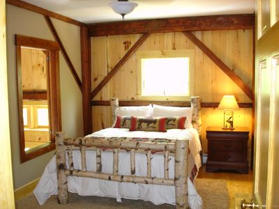 The Birch Bedroom with bedframe made from a tree from the property!