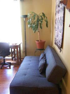 lounge room with clicker/convertible couch
