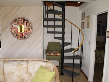'Curvaceous' spiral stairs leading to the well appointed loft bedroom.