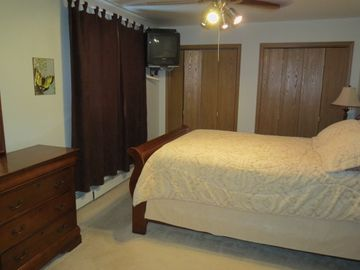 Master bedroom with Queen pillow-top bed, t.v. with cable