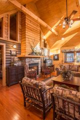 Pigeon Forge cabin photo - great room seating area for 10 around the 2 way fireplace with cathedral ceiling