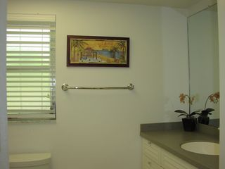 Captiva Island house photo - Renovated tub and tile shower with glass door.