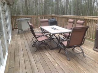 Pentwater cottage photo - 40 foot deck with gas grill, tables and seating for 10