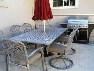 Anaheim house photo - Dining table set with 6 chairs and propane grill.