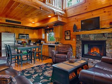 Sevierville cabin rental - Sit by the cozy stacked stone fireplace to warm up...