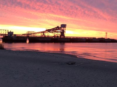 Picture of freighter dock at sunrise.