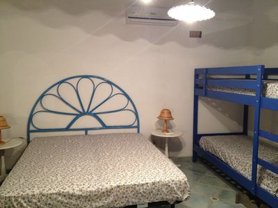 Aeolian Islands house rental - The other main room of the house, with 1 double bed and 2 singles, and A/C.