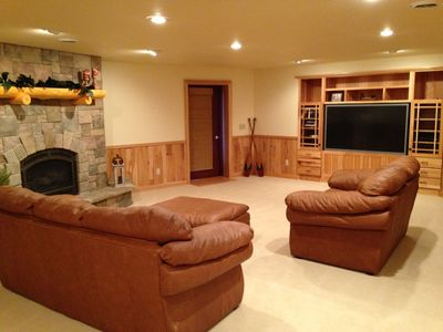 "Lower level entertainment area with 65"" TV, gas fireplace and walkout to lake"