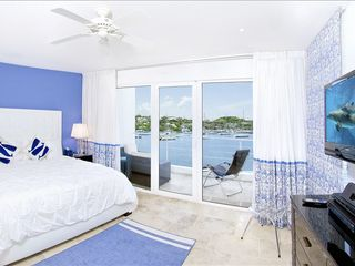 Dawn Beach house photo - Upstairs master bedroom suite with beautiful view of marina.