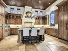 Kitchen  - A expansive kitchen with rustic wood and marble countertops