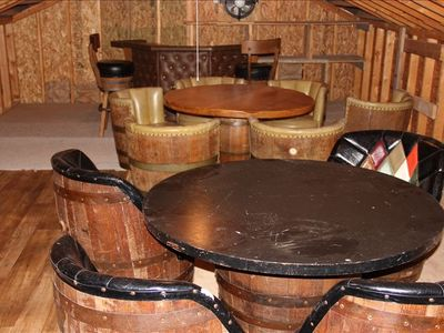 Rustic man room. With antique barrel chairs and bar. Seating for 12.