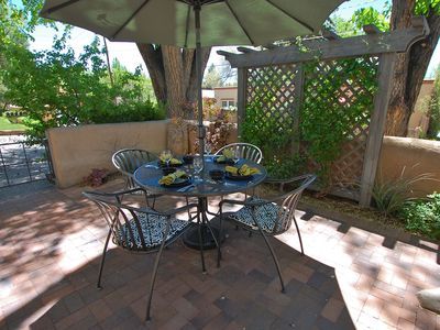 Beautiful Courtyard Patio with Dining Area and Trellis