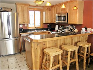 Steamboat Springs townhome photo - New Kitchen & Bar with Granite, Stainless Steel, & Hardwood.
