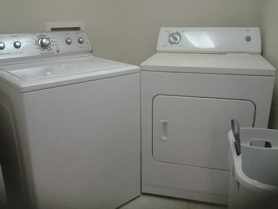 The laundry room has a full-size washer and dryer.