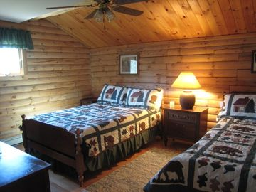 Second bedroom with full and twin beds