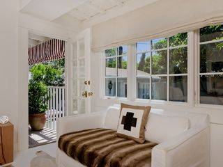 West Hollywood villa photo - master bedroom loveseat, door opens to deck and private pool area