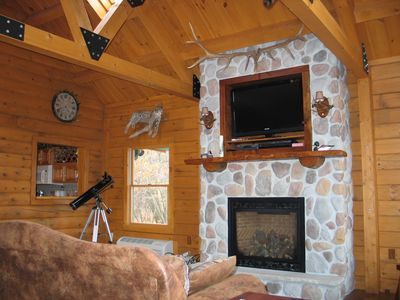 Huge stone fireplace with built in flat screen TV