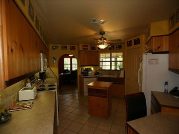 Large kitchen includes full size refrigerator, dishwasher, stove, & microwave