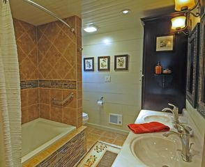 Taos Ski Valley house photo - Master Bath: soaking tub with custom stonework