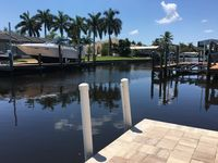 Beautiful, Private 2BR Home with screen covered pool, located right on the water