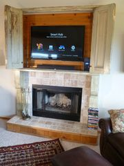 "Bandon house photo - Fireplace and TV cabinet - 47"" 1080P TV with blu ray player; basic 480P DirectTV"