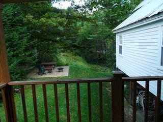 Freedom farmhouse photo - back deck and patio enjoy the river view!!