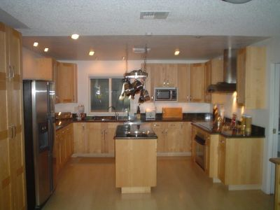 All Stainless Steel and Granite Countertop Kitchen