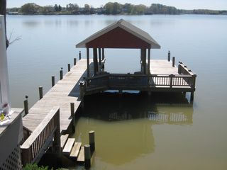 Colonial Beach cottage photo - Pier & boathouse with 25' covered slip, covered sitting & deck areas