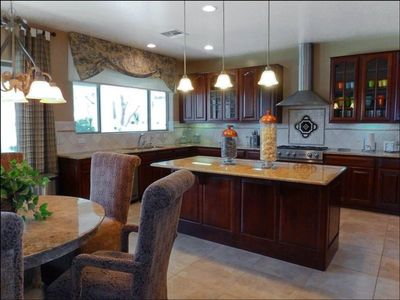 Large Kitchen with Granite Countertops and Stainless Steal Appliances