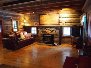 Rest on the comfy leather furniture. Unwind by the wood stove fireplace