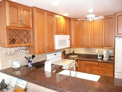 Enjoy the newly remodeled kitchen -beautiful cherry cabinets & granite counters