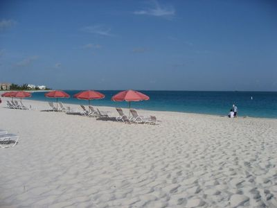 The Pink Umbrellas on the Beach at Ocean Club West -- Grace Bay Rental
