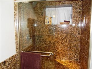 Woodley Park apartment photo - Shower stall with bench completed in Italian marble in the bathroom area