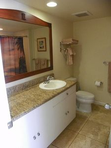 Long shot of sink and mirror / bathroom.